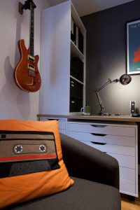 Retro Cushions and Guitar on wall