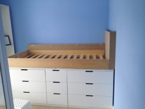 Ikea Hack Children's Cabin Bed : We built a shelf along the back wall and a custom made headboard using MDF.