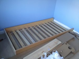 Emily's old bedframe with headboard and footboard removed and replaced with a