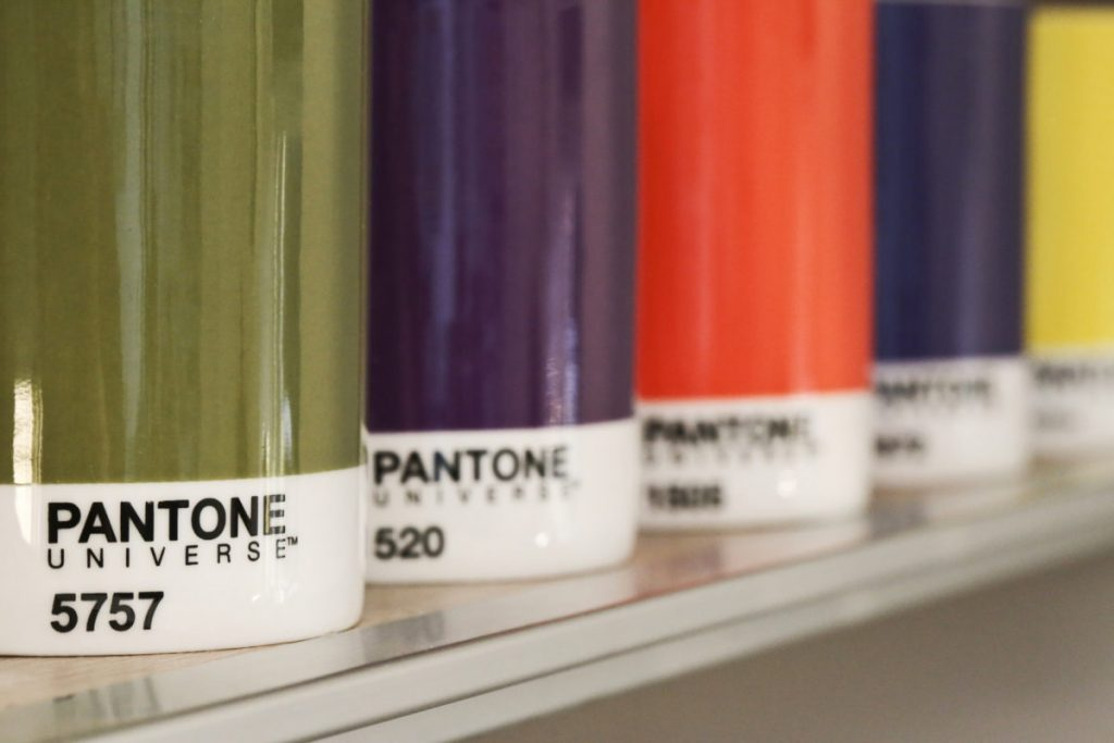 Pantone Universe mugs in cupboard