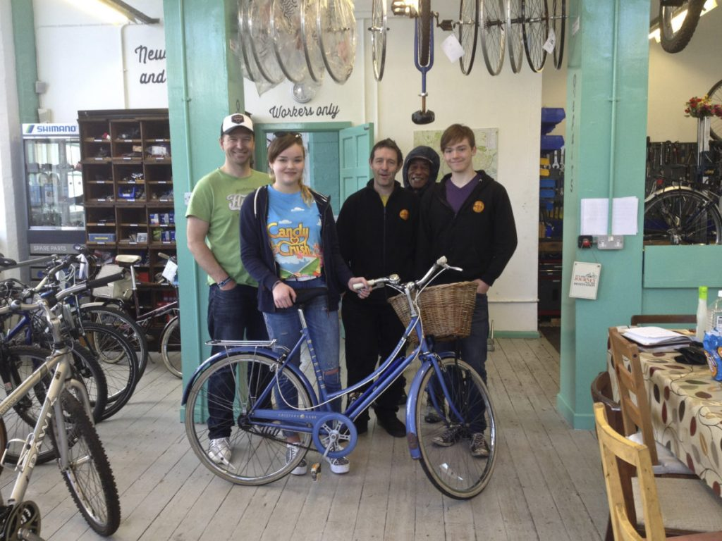 Beth, her bike and the staff at Nottingham Bike Works