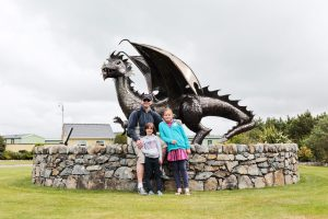 Richard and the girls pose with the dragon on the beautiful Min-y-Don caravan site in Harlech, Wales