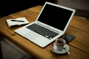 Desk, laptop, notepad, coffee