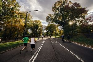People jogging along a road to keep fit and exercise