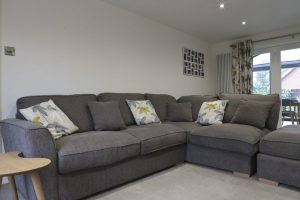 Corner Sofa Colour Scheme in our living room with teal and mustard cushions.