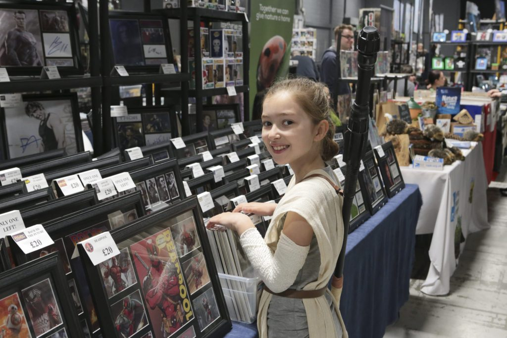 Emily looks at Merchandise at Manchester Film and Comic Con Stall