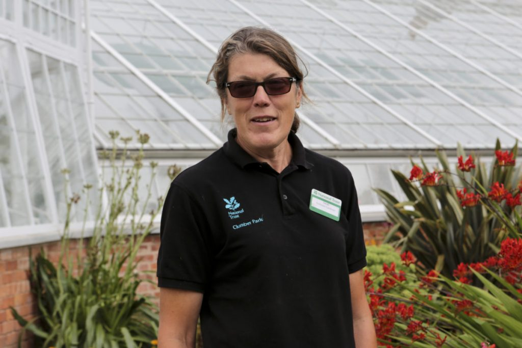 Sarah Elton, Assistant Gardener, National Trust, Clumber Park stainding in front of the longest glass house owned by the National Trust,