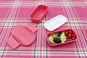 Polargear lunchbox (pink) opened up to reveal several compartments and cutlery section.