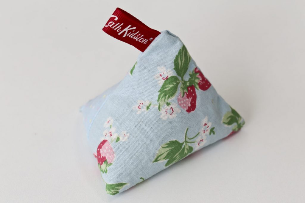 Blue pyramid shaped lavender bag made with red and pink leafy flowered Cath Kidston Style material and a Cath Kidston ribbon tag.