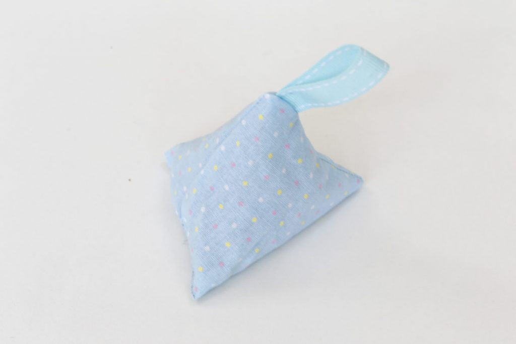 The pyramid lavender bag in blue material with spots , complete with blue looped ribbon tag is finished.