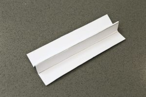 Fold the rectangle of cardboard as shown to create a fin
