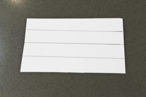 Mark a rectangle of cardboard cut to the same width as the cardboard tube as shown.