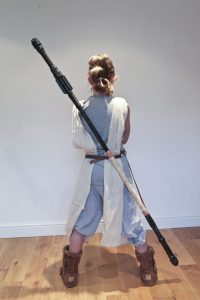 DIY Star Wars Rey Staff : Emily in her Rey Star Wars costume with back to the camera and staff strapped to her back