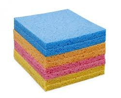 A pile of different coloured cellulose sponges