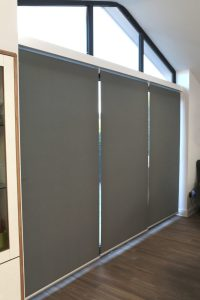 Our set of three full length grey blinds pulled down over our Glass sliding folding doors
