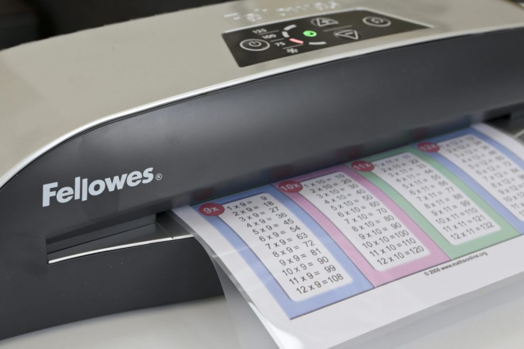A printable in a laminated pouch being fed into the Fellowes Callisto A4 Laminator