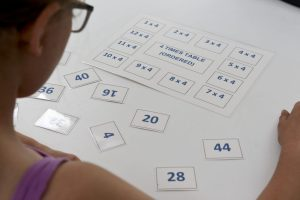 Girl playing Laminated multiplication game