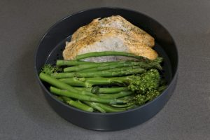 Salmon, Broccoli and green beans ready to eat after cooking on the Joseph Joseph M-Cuisine Microwave Steamer
