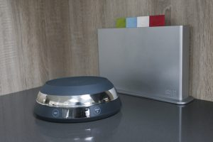 Joseph Joseph SwitchScale 2-in-1 Digital Scale with bowl facing downwards and chopping board in background