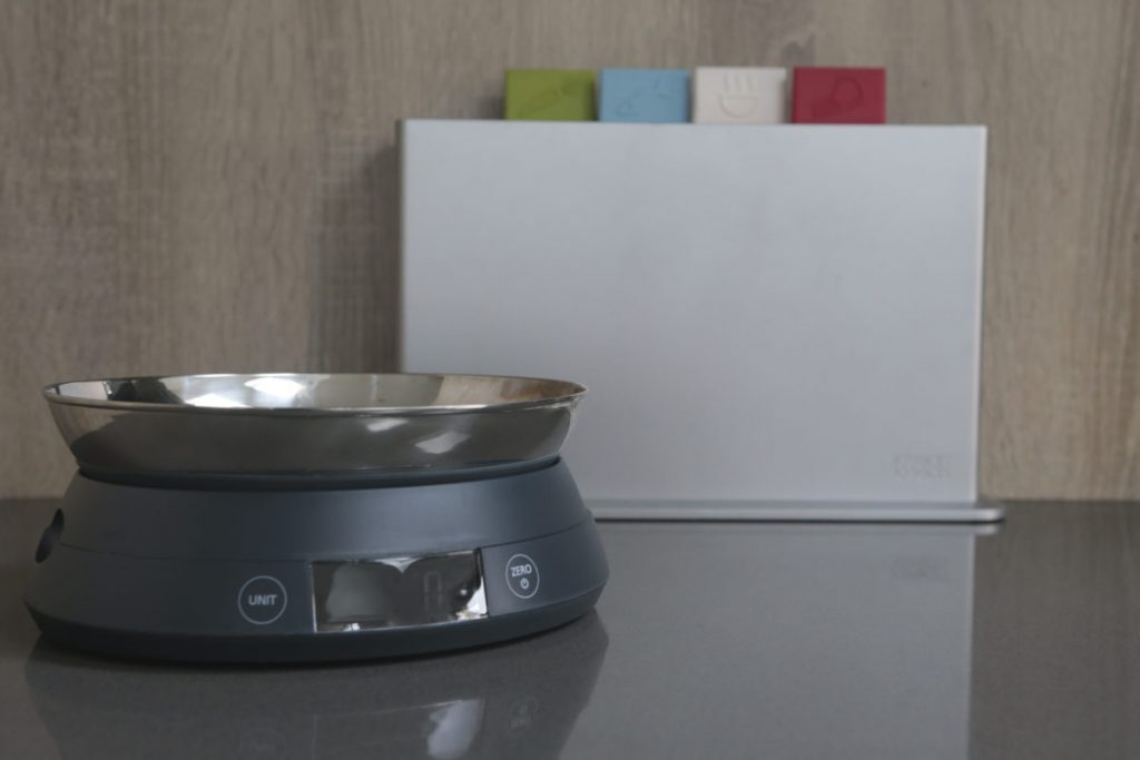 Joseph Joseph SwitchScale 2-in-1 Digital Scale with bowl facing upwards with chopping board in the background