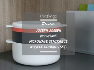 Text overlay: Review of Joseph Joseph M-Cuisine Microwave 4-piece stackable cooking set with chopping boards in background