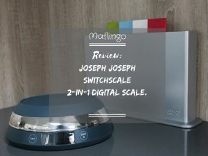 Joseph Joseph SwitchScale 2-in-1 Digital Scale Review Text Overlay With scale in foreground with bowl facing downwards and chopping boards in background
