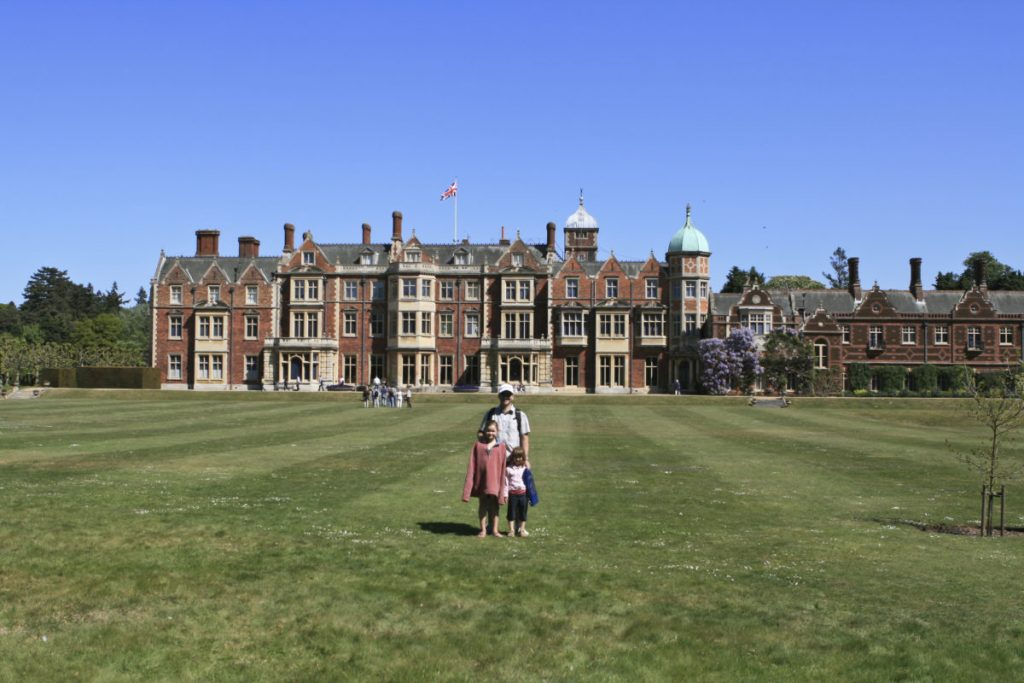 Richard, Beth and Emily standing in front of Sandringham Palace, Norfolk