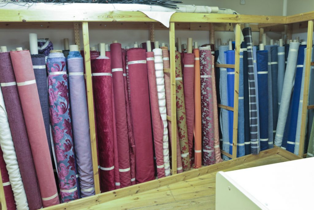 Downstairs in Bargain Fabrics, Castle Donington. Bargain fabric by the metre - rolls and rolls of it.