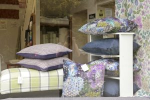 Window display at Bargain Fabrics, Castle Donington with cushions and soft furnishings.