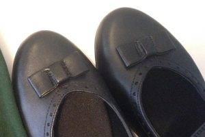 Close-up of the end of Emily's new school shoes