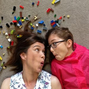 #Floorselfies Headshot of Emily and I laying on our neutral lounge carpet surrounded by Lego brick