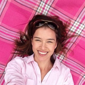 #Floorselfies Headshot od me with sunglasses on head laying on a pink tartan picnic blanket