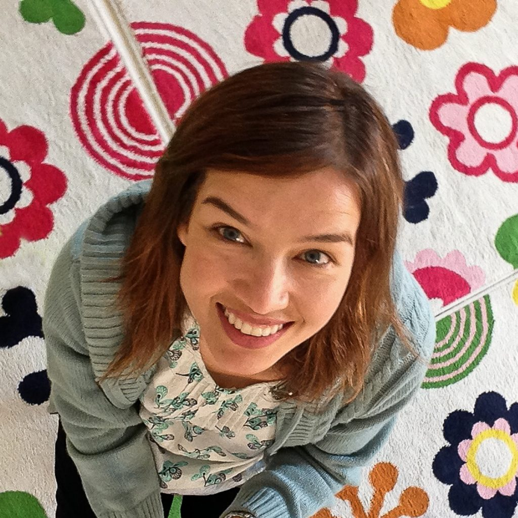 #Floorselfies Overhead shot of Me sitting on a colurful floral carpet in toddler group at church.