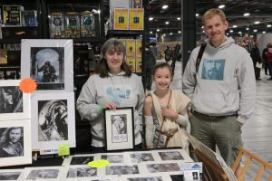 Introducing Chris Baker Art. Emily and Chris Baker's parents manning Chris's stall at Manchester Film and Comic Convention, 2016