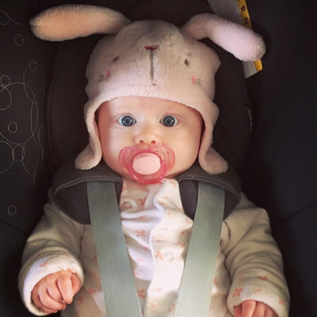 My Niece in her rabbit ear hat in a carseat