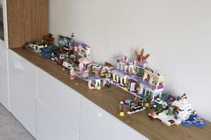 Lego Friends covering the entire sideboard in our grown up lounge.