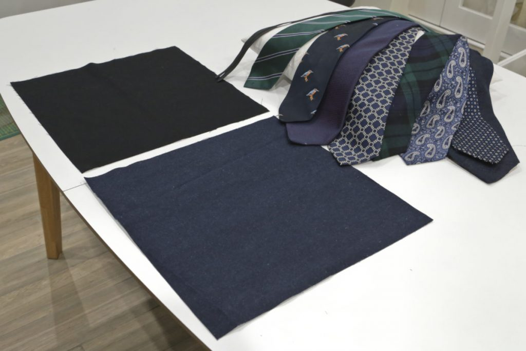 The ties, cushion pad, 15inch square lining and denim fabrics laid on a table prior to making the cushion