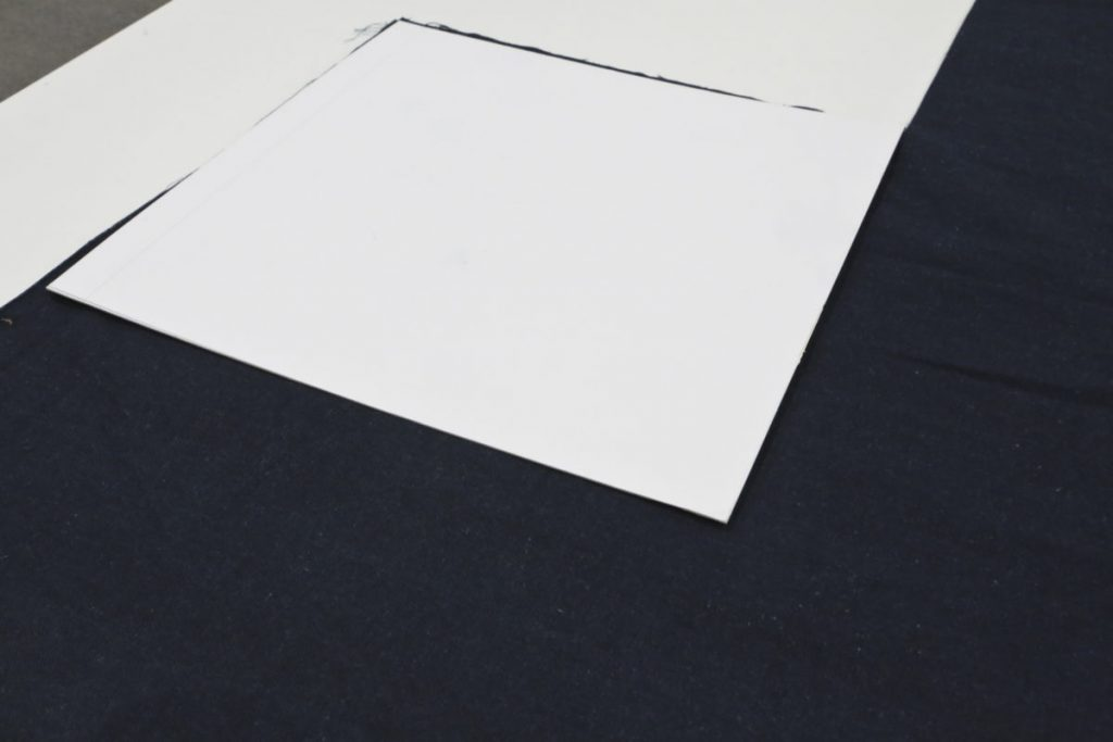 Use a 15 inch white cardboard template to measure and cut out the cushion fabric.