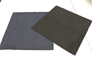 The square pieces of lining fabric and denim material for the cushion have been cut using the white cardboard templare