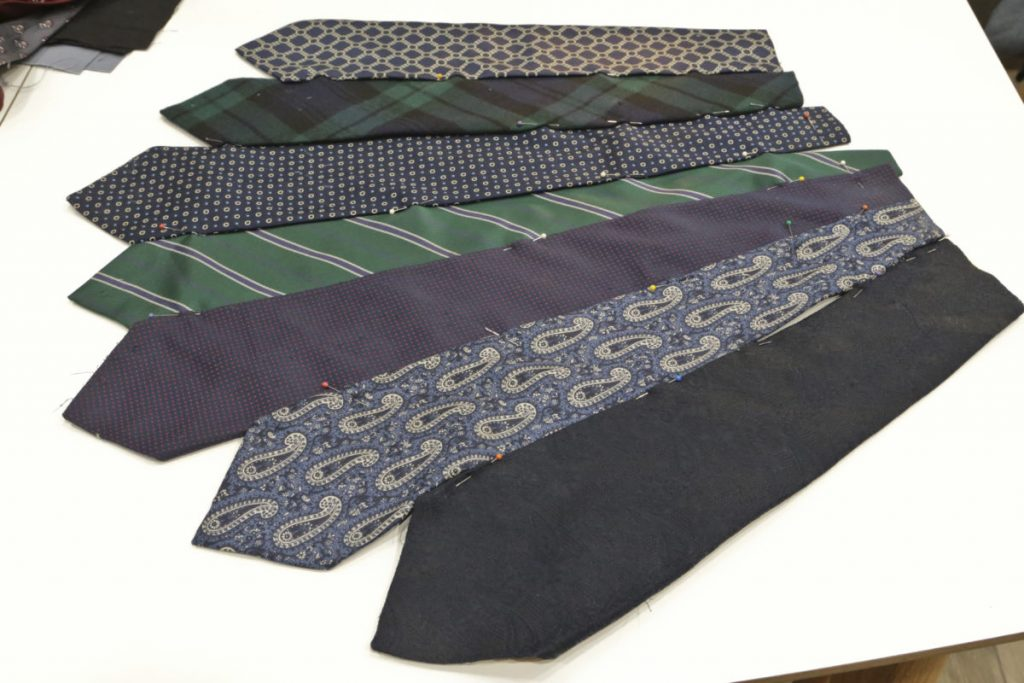 After arranging the ties using the cardboard template square as a guide. the ties are pinned in place prior to sewing them together on the sewing machine