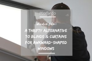 Window film, a thrifty alternative to blinds and curtains for awkward shaped windows overlay with Mr T applying window film with a squeegee.