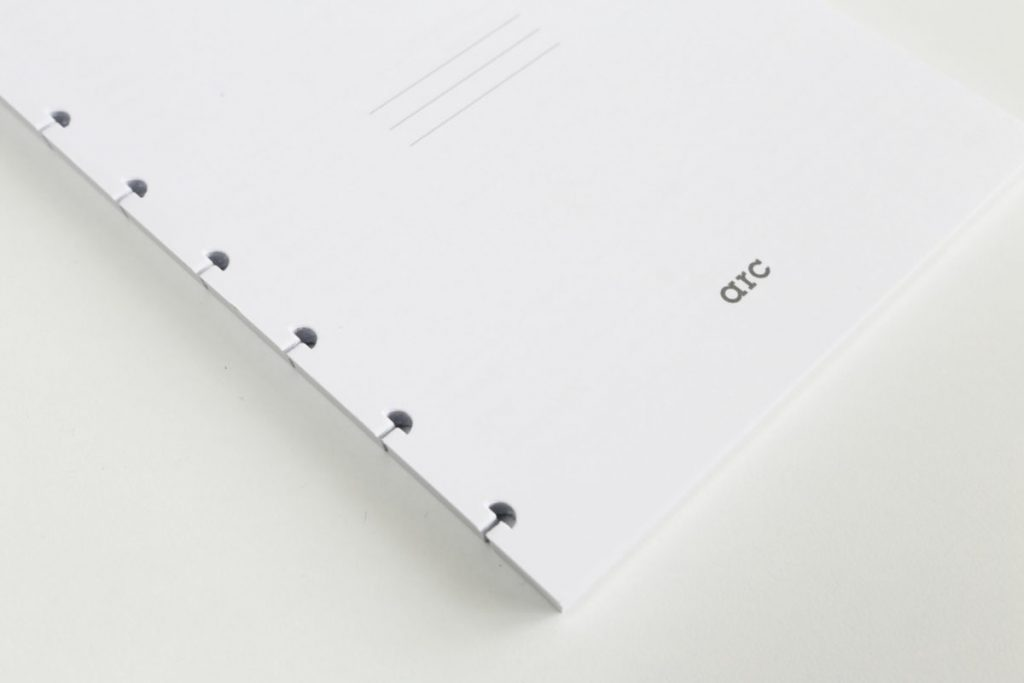 The Arc system hole punch has a unique punch pattern to enable the pages to be inserted onto the plastic disks.