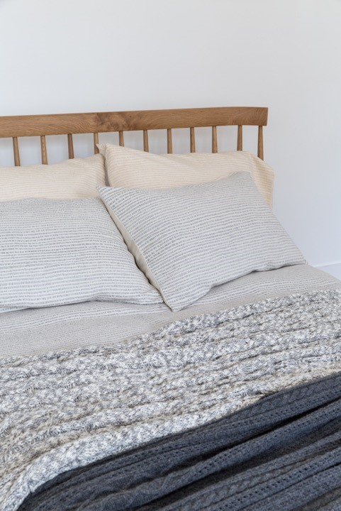 Cotton Cable Knit Natural/Grey Double 150cm x 200cm shown on a bed