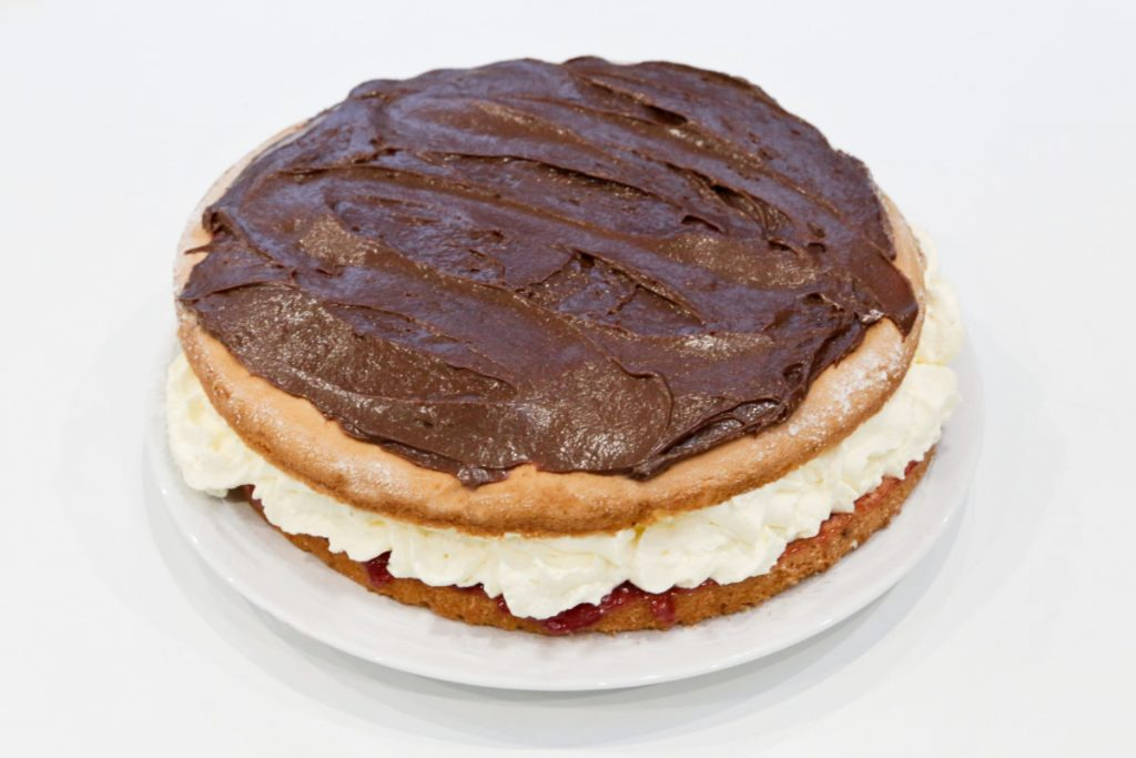 We spread chocolate flavour frosting on top of the sponge cake