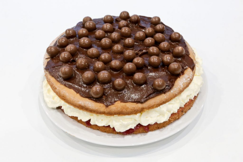 Arrange Maltesers evenly on top of the frosted cake