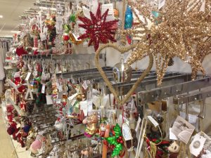 Lots of Christmas decorations hanging on the shelves at Homesense