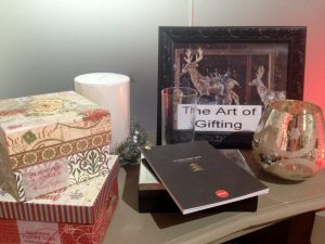 A selection of Homesense Christmas gifts including candles, books, boxes