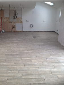 Our beautiful Vintage Ash Porcelain floor tiles stretch from wall to wall, ready for our new kitchen.