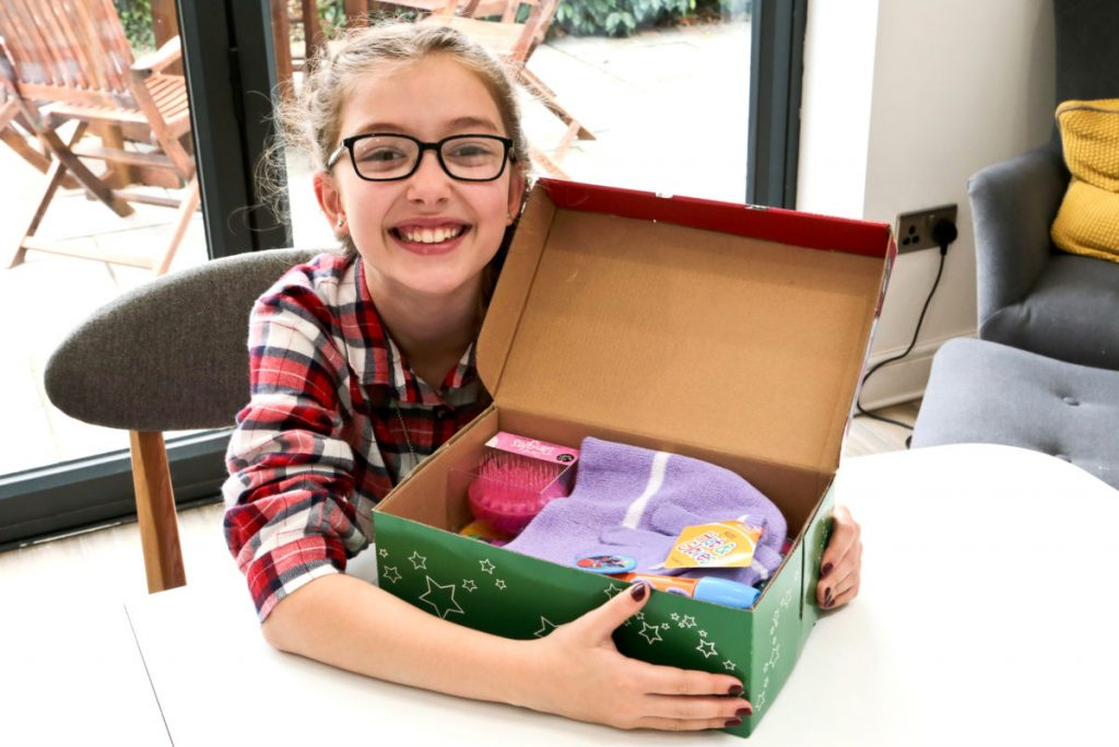 Emily with her filled Christmas SHoebox