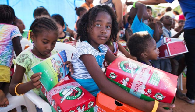 Children receiving their Christmas Shoeboxes.